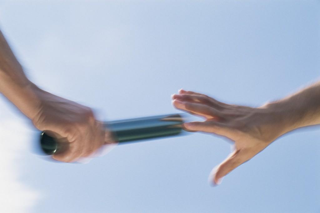 Hand Passing Baton, Motion Blur